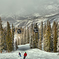 Aspen Skiers Under The Gondola by Adam Jewell
