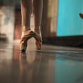 Ballerina Standing In Ballet Shoes by Anna Jurkovska