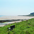 Bamburgh Castle And Beach by Victor Lord Denovan