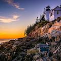 Bass Harbor Lighthouse At Sunset, In by Jon Bilous