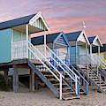 Beach Huts Sunset by Gill Billington