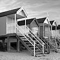 Beach Huts Sunset In Black And White by Gill Billington