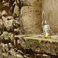 beer bottle left in old lane in Edinburgh by Victor Lord Denovan