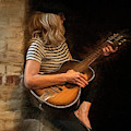 Blondie Woman Playing Guitar Sitting On A Brick Wall by Dan Friend
