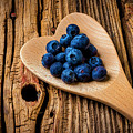 Blueberries In Heart Shaped Spoon by Garry Gay