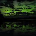 Boot Lake Green And Purple Northern Lights  by Dale Kauzlaric