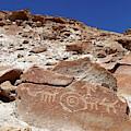 Boulder With Petroglyphs At Ofragia Chile by James Brunker