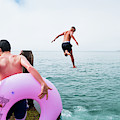 Boys Jumping Into The Sea by Keith Morris