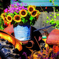 Bucket Of Sunflowers On Old Tractor Seat by Garry Gay