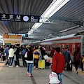 Busy Platform With Passengers Exiting Trains And Greeting At Beijing Railway Station China by Imran Ahmed