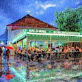 Cafe Du Monde - New Orleans In The Rain by Mark Tisdale