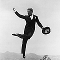 Cagney Leaping In Formal Attire by Getty Images