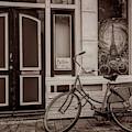 City Bike Downtown In Sepia by Debra and Dave Vanderlaan