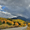 Clouds Breaking Over Sunshine Mountain Light Golden Aspens by Ray Mathis