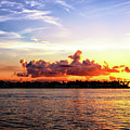 Clouds Over Sunset Key At Night In Key West by John Rizzuto