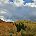 Clouds Pass Over Hills Of Colorful Aspens by Ray Mathis