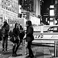 Cold At Times Square New York City by John Rizzuto