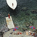 Coming Ashore by Slim Aarons