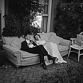 Couple At Party by Thurston Hopkins