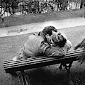 Couple Of Lovers Kissing On A Bench At The Pere Lachaise, Paris, 1955 by Gerald Bloncourt