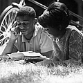 Couple Reading by Hulton Collection