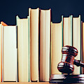 Court Hammer And Books On Black Background. by Michal Bednarek