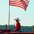 Cowboy And American Flag by Dennis Dame