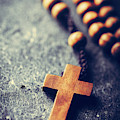 Cross And Rosary On Stone Background. by Michal Bednarek