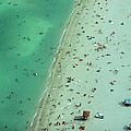 Crowd Along Shoreline Of Miami Beach by Cameron Davidson