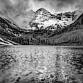 Dark Clouds Falling On The Maroon Bells - Black And White by Gregory Ballos