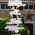 Directional Mileage Signs by Susan Candelario