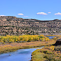 Distant Boat On The San Juan River In Fall by Brenda Landdeck
