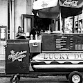 Eating A Lucky Dog In New Orleans by John Rizzuto