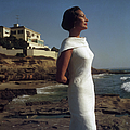 Elegance On The Beach by Slim Aarons