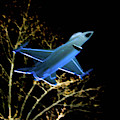 F 16 Lit Up At Night On Glass Monument by William Rogers