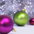 Festive Scene For Christmas With Xmas Balls And Lights In Backgr by Cristina Stefan