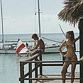 Fishing On Honeymoon Porch by Slim Aarons