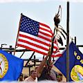 Flags At A Powow Grand Entry by Kae Cheatham