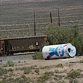 Giant Beer Can In Nevada Desert Near Train Tracks by Colleen Cornelius