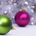 Green And Fuchsia Christmas Balls And Lights In Background. Wint by Cristina Stefan