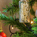 Hanging Decor On A Christmas Tree by Iordanis Pallikaras