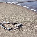 Heart Made Of Pebbles On Sand by Angelika Kaczanowska