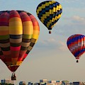Hot Air Balloons Flying Over The City by Tatiana Travelways