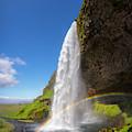 Icelandic Waterfall by Debra and Dave Vanderlaan