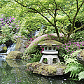 Japanese Lantern In Pond Surrounded By by Bryan Mullennix