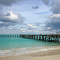 Jetty On Cancun Beach, With Grey Clouds by Sean Caffrey