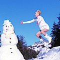Kristen Mcmenamy In Dolce And Gabbana With Snowman by Arthur Elgort