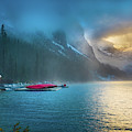 Lake Louise Canoes In The Morning by Inge Johnsson