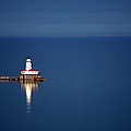 Lighthouse On A Lake by By Ken Ilio