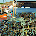 lobster pots and trawlers at Dunbar harbour by Victor Lord Denovan